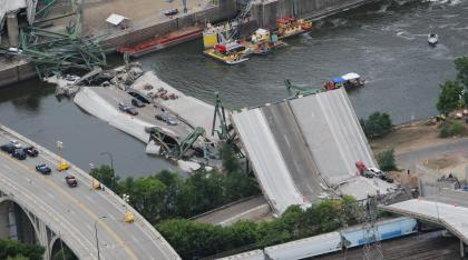 An aerial view shows the collapsed I-35W bridge 04 August 2007 in Minneapolis, Minnesota. Five people have been confirmed dead and 8 others missing following the 01 August bridge collapse during rush hour. AFP PHOTO/Mandel NGAN (Photo credit should read MANDEL NGAN/AFP/Getty Images)